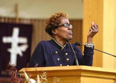 The Rev. Laura Ahart's call to ministry takes her to many places, filling many needs. Here, she delivered a prayer of comfort during a funeral service at Twelfth Baptist Church on Tuesday. She is the pastor of United Baptist Church in Jamaica Plain.